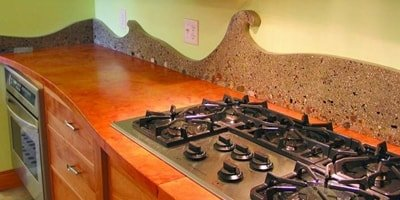 Kitchen concrete countertop creates a unique look around a stove