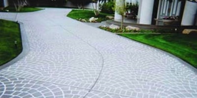 Universal Templates stencil was rolled onto this driveway and creates a uniform pattern