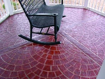Red concrete overlay in a brick fan pattern.