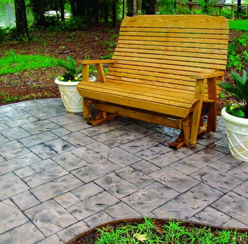 Cute bench sits on a stamped concrete overlay that looks like stone.