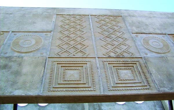 Inca design imprinted into a concrete wall during placement using concrete formliners.