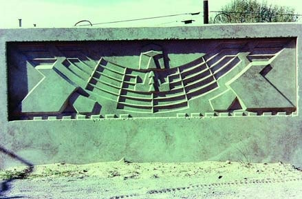 Large roadside sign logo made of concrete by using a concrete form liner. Decorative forms by Greenstreak Inc.