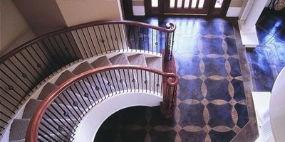 The bottom of this grand entrance staircase has been acid stained giving the concrete a rich look.