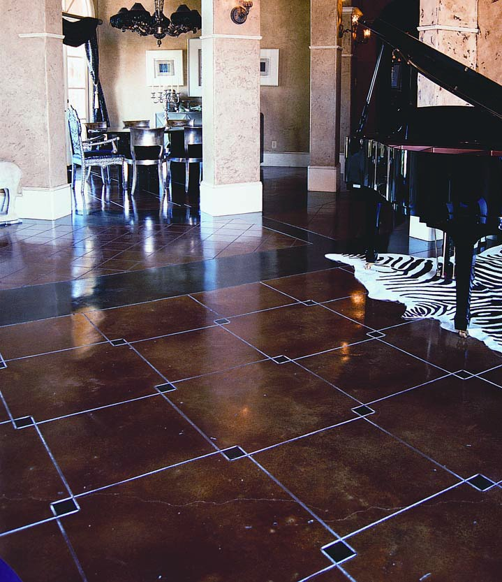 Geometric squared are placed in this concrete floor and acid stained to accent the overlapped corners of the squares.