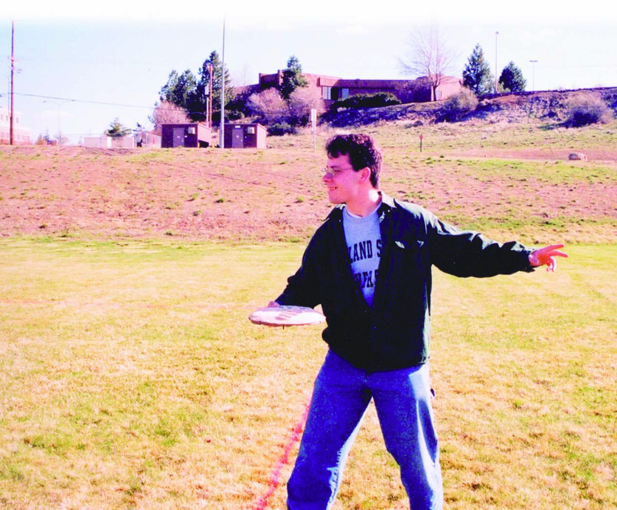 A student takes a concrete frisbee for a test run.