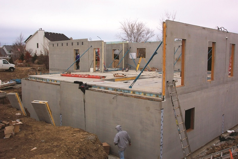 Precast concrete is used to tilt these walls up of this concrete home.