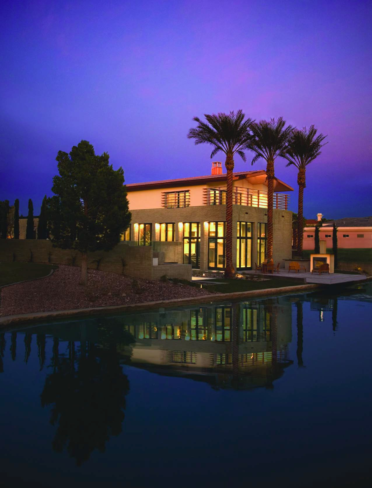 "Constructed by Merlin Contracting, L.L.C., the $1.9 million, 5,180- square-foot New American Home 2004 is in the luxury community of The Lakes at West Sahara, about 15 minutes from the Las Vegas Strip.The home is described to have a modern ""loft"" design."