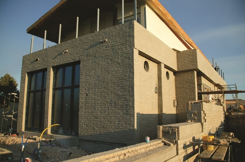 TNAH's exterior finish features decorative concrete masonry and stucco.