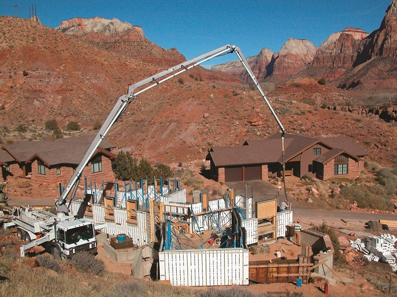 Concrete pump trucks are used to fill the ICF blocks for the concrete home