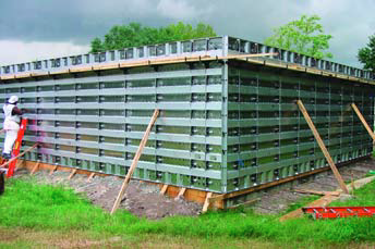 Concrete cast-in-place walls are created for this large building using removable forms.