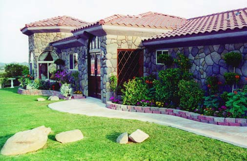 Home that enhanced with rock features that have been created by hand.