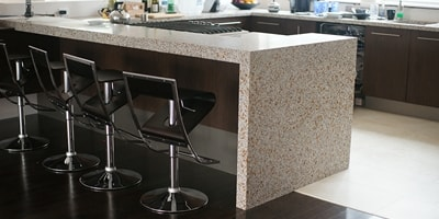 This infinite edge precast terrazzo countertop is stunning in this modern kitchen
