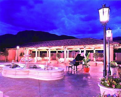 The Broadmoor Hotel lit up at night is a perfect place for a luxurious concrete patio
