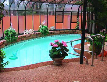 Backyard indoor pool with a updated pool deck