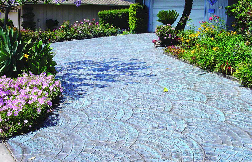 Driveway stamped and colored with Super Krete products in a radial fan pattern.