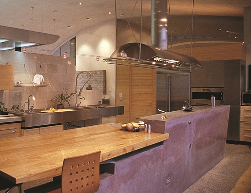 A modern kitchen with a wood and concrete countertop.