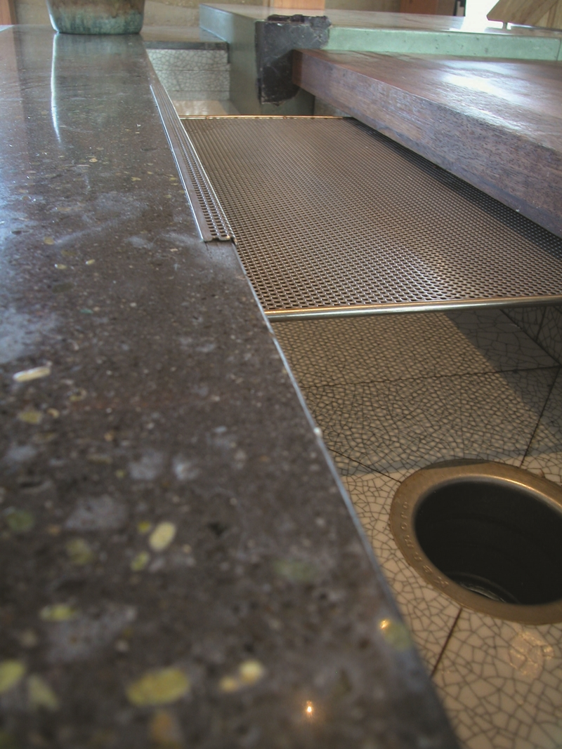 Concrete countertops are perfect for adding small details like a drain board seen here.