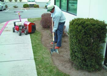 To prep a space for decorative concrete curbing, cut a trench that measures 2 inches by 9 inches, with a depth of 1 inch to 2 inches