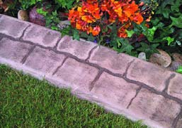 Concrete curbing creates a edge that looks like natural stone.