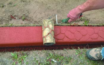 Using a texture roller on decorative concrete curbing can be a quick and easy way to take your concrete curb to the next level.