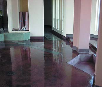 Reflective concrete floor that has been acid stained