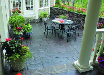 An outdoor plain concrete patio is transformed with the use of QC Construction Products vibrant color palette.