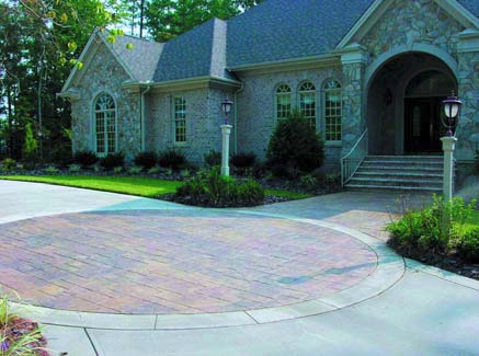 QC Construction products were used to create this expansive stamped concrete driveway.