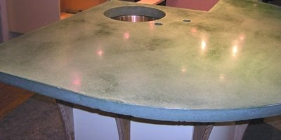 Precast concrete countertop with a hole for a sink and faucet.