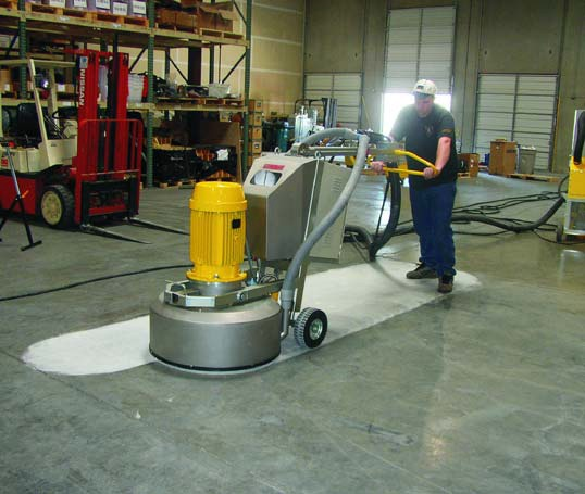 Polishing Concrete Floor - Shannon Ware, vice president of Concrete Restoration Inc. in Seattle, says the densifier also helps to lock in the color of an acid stain and harden the surface so that when you begin to polish you're not removing color. For best results, he adds, a stain should be introduced during the higher level of the polishing process. Shane Siefken, general manager of Justrite Surfaces in Council Bluff, Iowa, says his crew typically applies the densifier after the 120- or 220-grit diamond application. All three men agree that the application of a densifier will slightly darken the color(s).