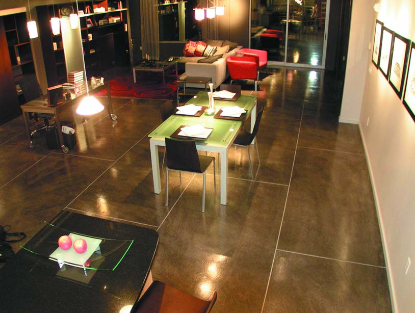 Mikhal Zambon floor design concrete stained restaurant floor in a extra large rectangle pattern.
