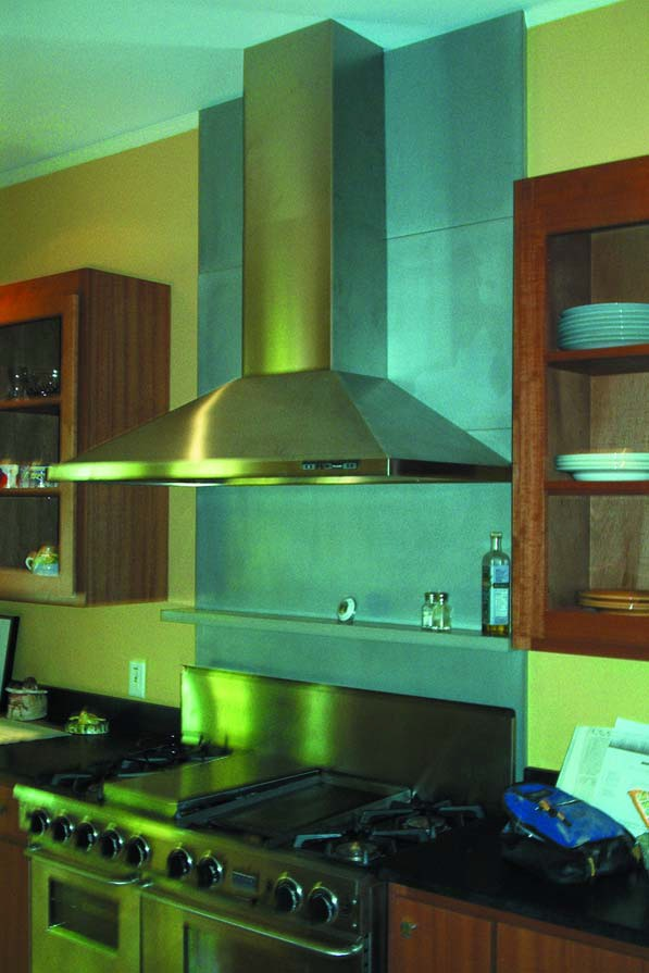Metakaolin - Kitchen countertop and splash behind oven hood. Photograph courtesy of Concrete Encounters