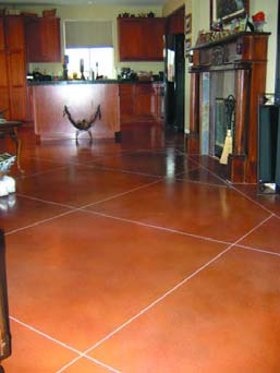 concrete Floor Dyes in a large tile pattern in terracotta.