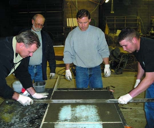 Students learning how to precast concrete countertops at the Concrete Countertop Institute.