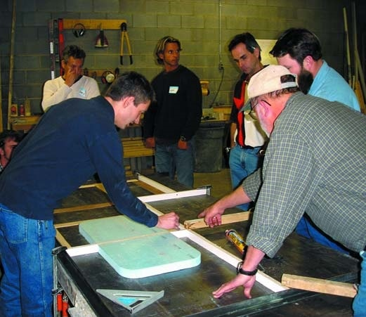 Jeffrey Girard of the Concrete Countertop Institute shows a group of students how to layout a sink mold prior to precasting a concrete countertop.