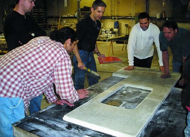 Jeffrey Girard with students, teaching how to precast concrete countertop at Concrete Countertop Institute.