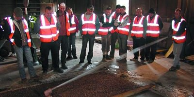 Students learning decorative concrete at a training center in the UK.