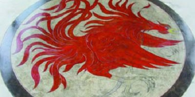 Red phoenix engraved and colored concrete design.