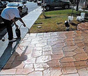 spraying sealer to an stamped and textured concrete driveway - In choosing a sealer, your decision will likely be based on the desired aesthetics and the protection you need. But in applying a sealer, the specific criteria of the job — indoors or outdoors, smooth or textured surface, film-forming or penetrating sealer, and water-based or solvent-based — will dictate the proper equipment and application method.