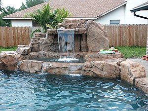 Concrete faux rock pool - This waterfall combines modular technology with older structural methods using rebar and concrete.
