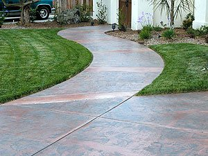 stamped curved walkway - The walkway makes a gentle curve toward the courtyard gate.