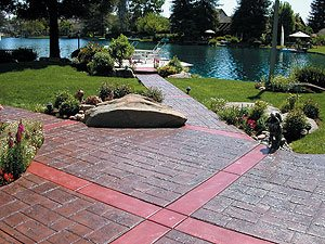 stamped walkway - Accent bands allow ashlar slate pattern to redirect. Some deep scoring is hidden in bands.