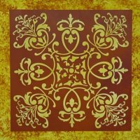 Square stenciled area on a floor in deep reds and golds appears to be a rug where there is not rug.