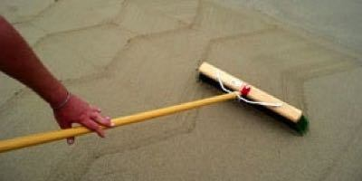 Try out a broom finish technique for concrete in sand.