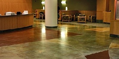 Medical clinic with polished concrete floors that have been colored using acid stains which gives a more muted color to the concrete.