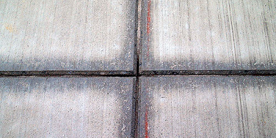 After determining how far apart you should place the concrete control joints, how deep should you cut them? Well, that all depends on whom you ask.