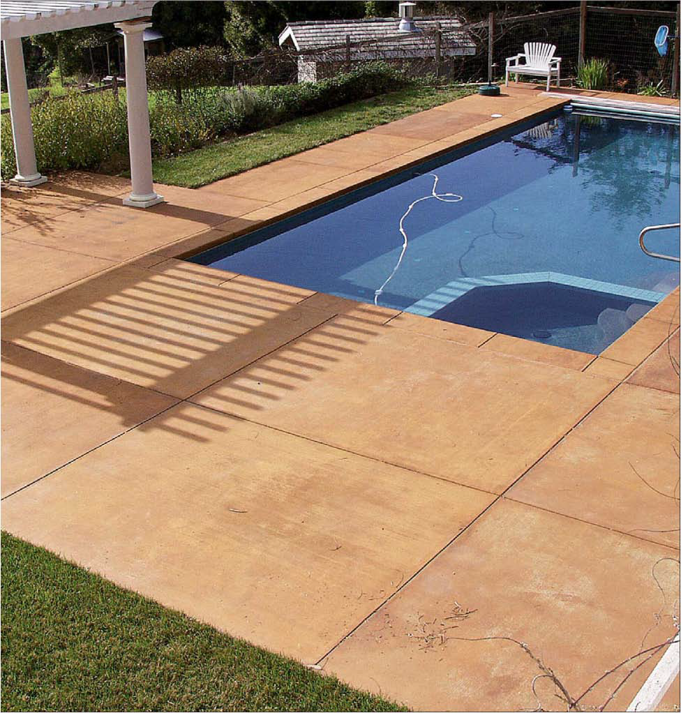 "As the trend toward backyard ""resorts"" continues, imprinted concrete is a popular choice for pool decks. This gives a more natural ""outdoorsy"" look than plain, flat concrete. In addition, Wennersten points out, ""A stamped texture makes voids for air underfoot so the concrete doesn't feel so hot."""