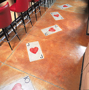 Playing cards are engraved and colored on this concrete floor.