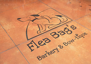 Flea Bag's Barkery and Bow-tique logo stained concrete logo.