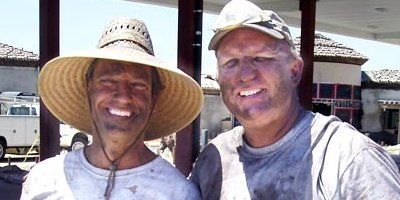 Mike Row and Richard Smith pose for the camera after a dirty job spreading concrete color hardener.