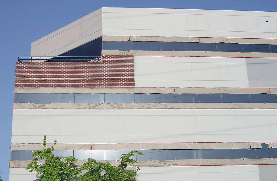 After using window-washing equipment to scale the sides of the 15-story office building, Scott's crew used lasers to get their lines straight. Starting at the top and working their way down, they also did what they could to square their pattern with pre-existing joints in the poured-in-place building. The old hand-cut joints weren't exactly laser straight.